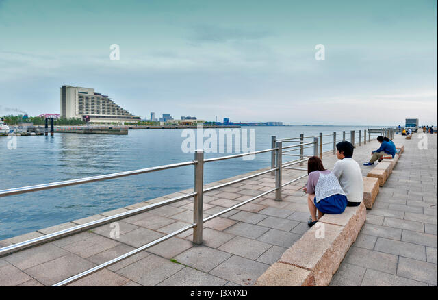 Kobe, Japan - April 2016: People relaxing at Kobe Port waterfront - Stock Image