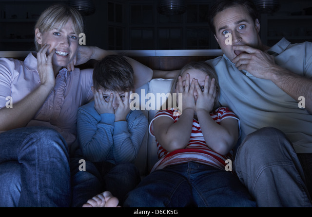 kids watching tv at night. exciting,family,tv night - stock image kids watching tv at