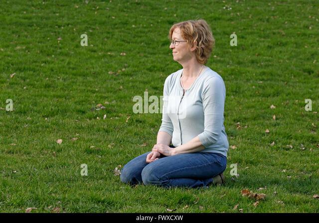 squatting position woman jeans