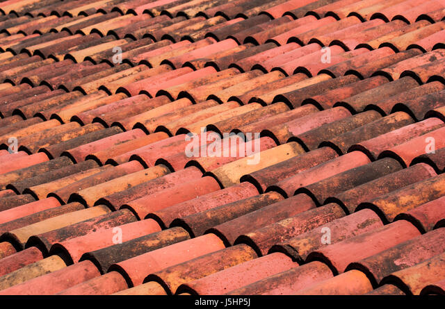 A Mexican terracotta tile roof wave pattern and texture as background - Stock Image : mexican roof - memphite.com