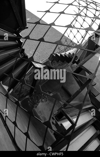 A Black And White Spiral Staircase Outside Of An Old Warehouse   Stock Image