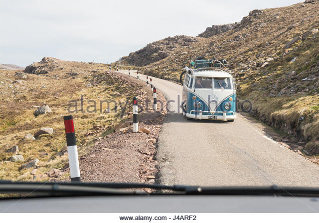 North Coast 500, Scotland - classic VW camper van using a passing place on Bealach na Ba road - seen through oncoming - Stock Image