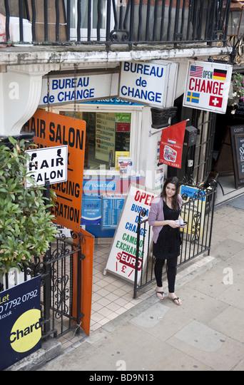 money shop change woman stock photos money shop change woman stock images alamy. Black Bedroom Furniture Sets. Home Design Ideas