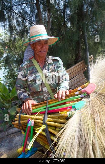Street vendors selling dried grass brooms on the island of ko samui