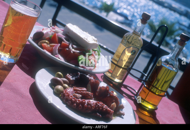 lunch-of-greek-salad-octopus-and-beer-in