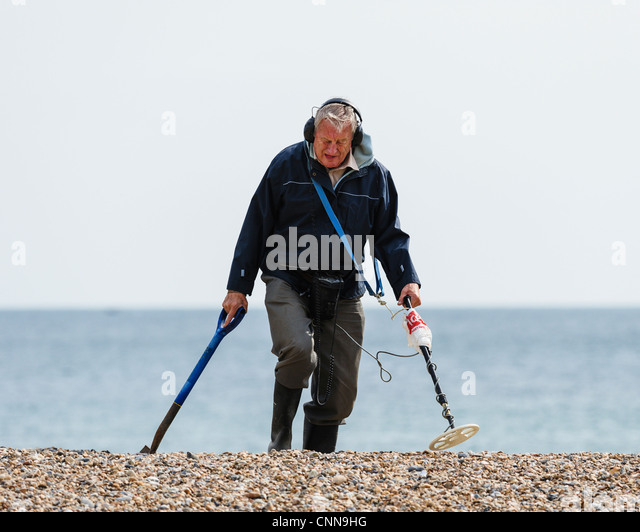 Jew Detector: Man Using Metal Detector On Stock Photos & Man Using Metal