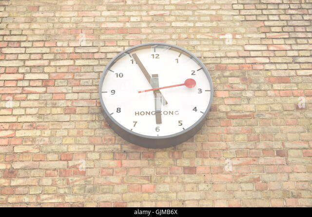 Clock On A Wall Showing Hong Kong Time   Stock Image