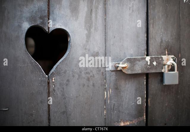 old door with a heart padlocked & Padlocked Door With Hole Stock Photos \u0026 Padlocked Door With Hole ... Pezcame.Com