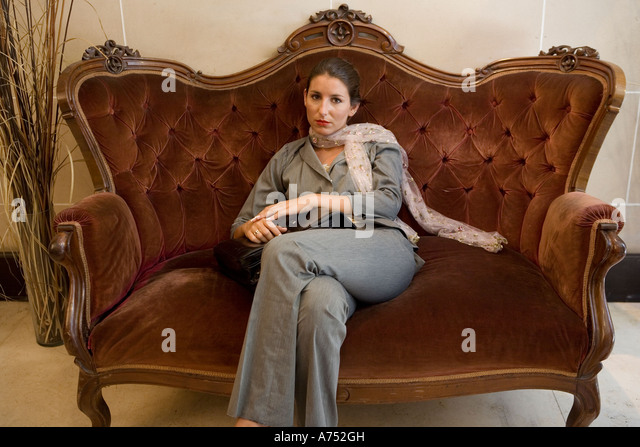 Businesswoman Sitting On Old Fashioned Sofa   Stock Image