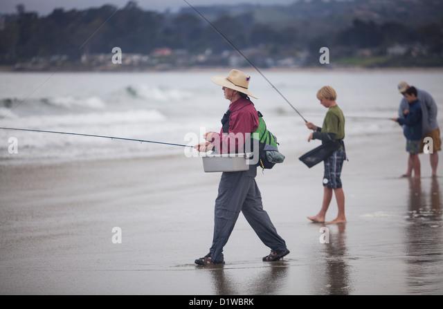 Child fishing casting stock photos child fishing casting for Santa barbara fishing