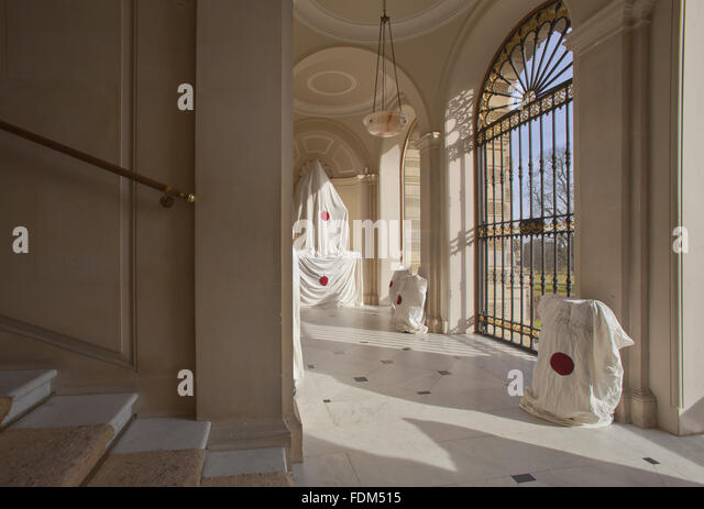protective covers over sculpture in the loggia at kingston lacy dorset stock image