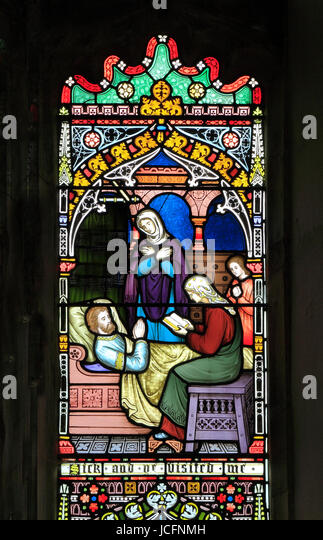 Corporal Acts of Mercy window, stained glass window by Frederick Preedy, 1868, visiting the sick, Gunthorpe, Norfolk, - Stock Image