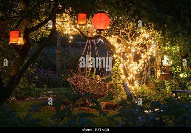 outdoor fairy lighting. garden at night with lanterns and fairy lights stock image outdoor lighting