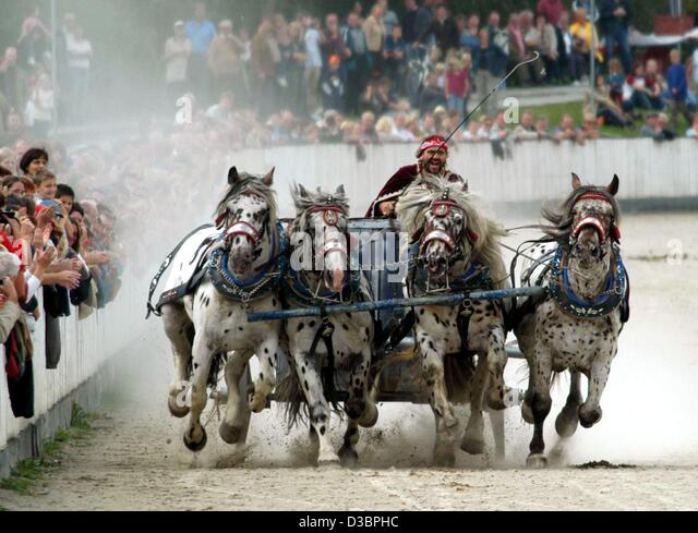 [Image: dpa-a-roman-chariot-races-past-spectator...d3bphc.jpg]