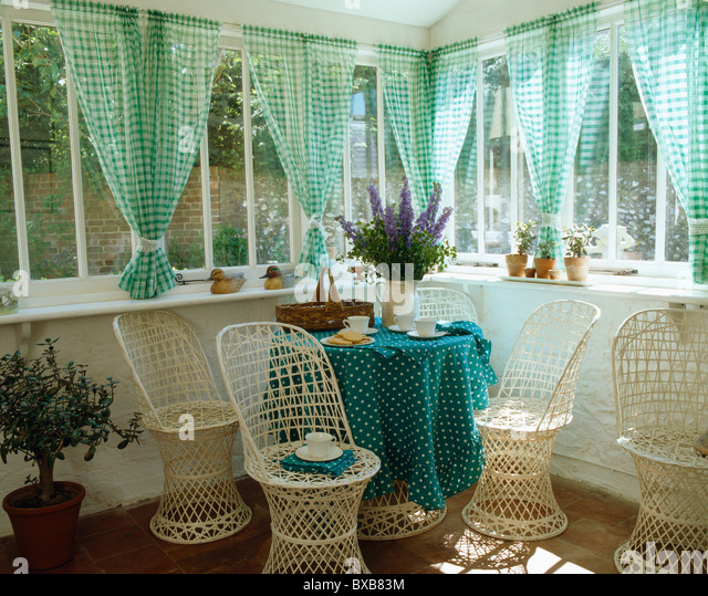 Cane Chairs And Table With Spotted Green Cloth In Small Dining Room  Extension With Green Checked
