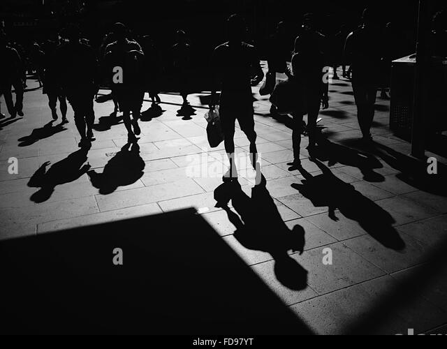 Silhouette Of People Walking On Street: Mixed Age Group Black And White Stock Photos & Images
