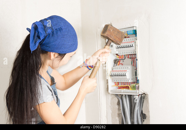 fuse box household stock photos fuse box household stock images w taking aim at an electrical fuse box a large wooden mallet in an effort