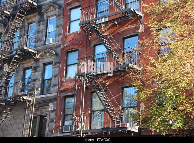 Apartment Building Fire Escape Ladder fire escape ladders on building stock photos & fire escape ladders