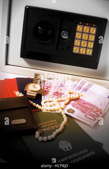 Valuables in front of a safe - Stock Image