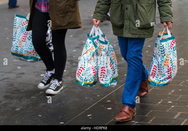 Poundland logo stock photos poundland logo stock images alamy shoppers with christmas gift bags of purchases in liverpool one two merseyside uk negle Choice Image