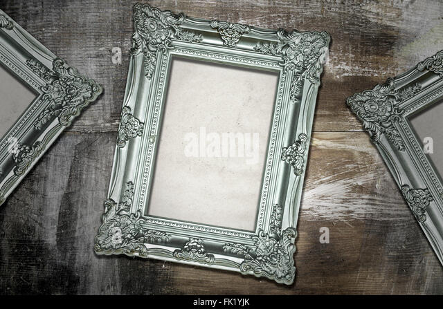 silver antique picture frames. Silver Antique Frames On Weathered Wood Background - Stock Image Picture