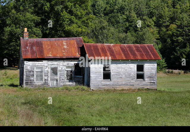 Abandoned Weather Beaten Cabin With A Rusted Metal Roof. Adirondack State  Park Adirondacks New York