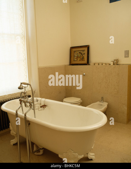 Roll Top Bath In Modern Bathroom With Limestone Tiling   Stock Image Part 81
