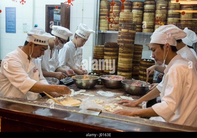 Restaurant Kitchen Chefs chinese restaurant kitchen chefs stock photos & chinese restaurant