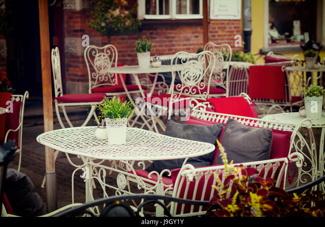 Cafe chairs flowers stock photos
