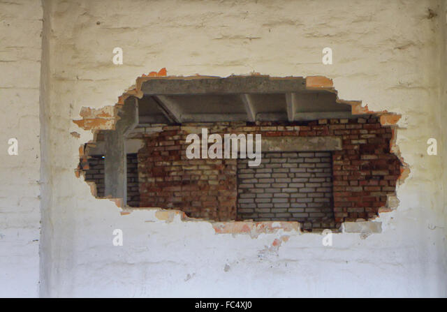 Hole In Concrete Wall : Concrete wall damage bullet stock photos