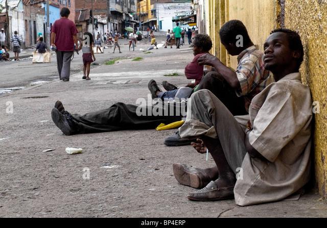 Colombian drug addicts lying on the street in the slum of Calvario ...