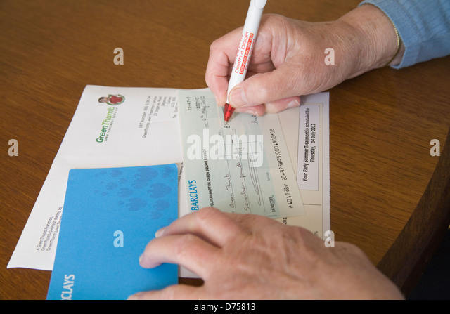 Cheque bank uk stock photos cheque bank uk stock images alamy uk elderly woman writing a barclays bank cheque to pay for recent lawn treatment stock ccuart Images