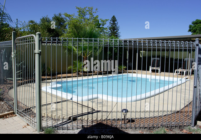 Pool safety fence stock photos