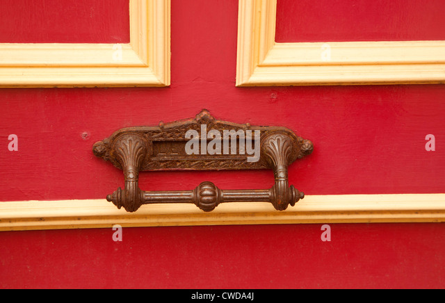 Letter box on a red door - Stock Image