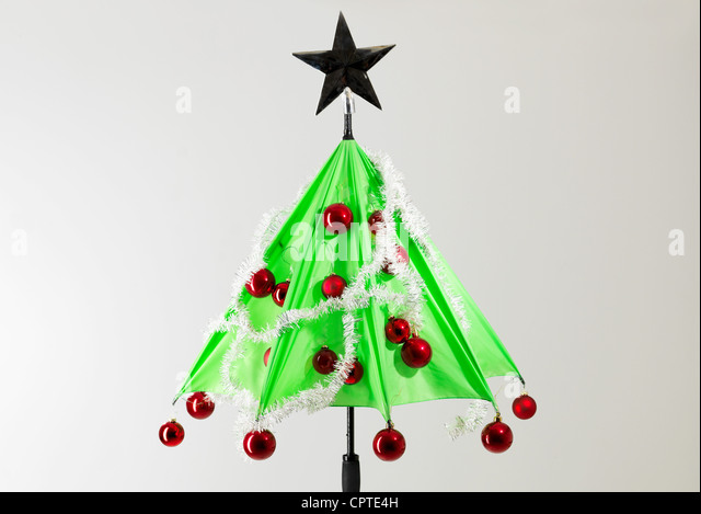 green umbrella with christmas decorations against white background stock image - Umbrella Christmas Tree