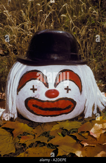 Sitting clown stock photos sitting clown stock images for Clown pumpkin painting