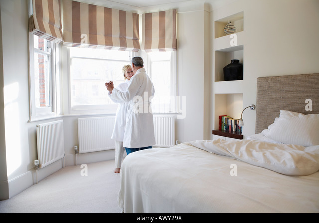 Middle aged couple dancing in bedroom   Stock Image. Couple Dancing In Bedroom Stock Photos   Couple Dancing In Bedroom