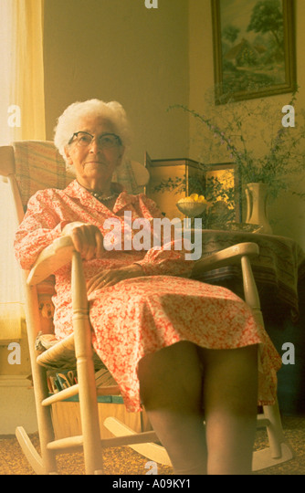 Old woman rocking chair stock photos