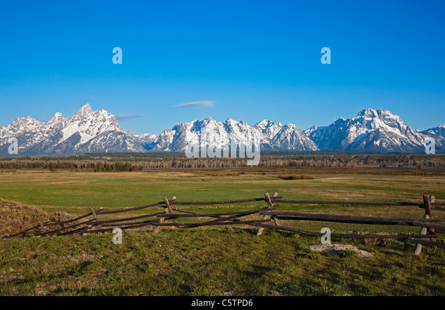Pasture and wooden fence sky stock photos
