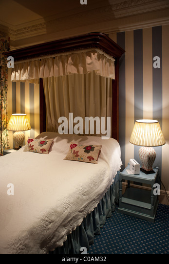 double bed with bedside lamps stock image