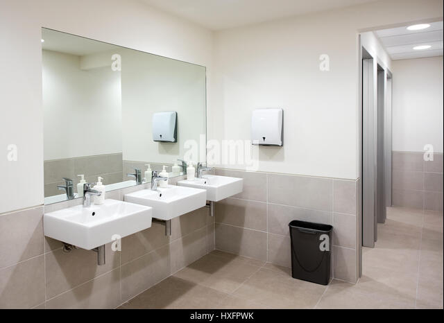 Public bathroom or restroom with a row of three hand basins with soap  dispensers below a. Public Bathroom Mirror Stock Photos   Public Bathroom Mirror Stock