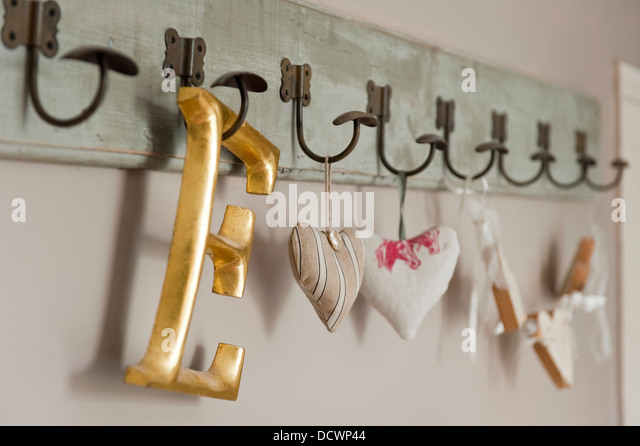 fabric hearts and capital letter on coat hooks in bristol home of british fabric designer emily