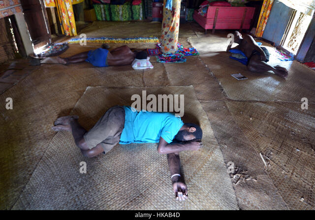 BA, FIJI   DEC 30 2016:Indigenous Fijian Men Lay Wasted On The Floor