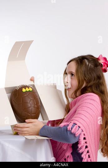 Box of chocolates children stock photos box of chocolates young girl opens gift of chocolate easter egg stock image negle Images