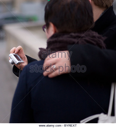 Person taking pictures with s compact digital camera - Paris France ...