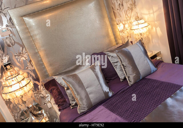 Home interior  bed and headboard  purple  mauve  silver cushions  h. Bedroom Wall Bed Cushions Stock Photos   Bedroom Wall Bed Cushions