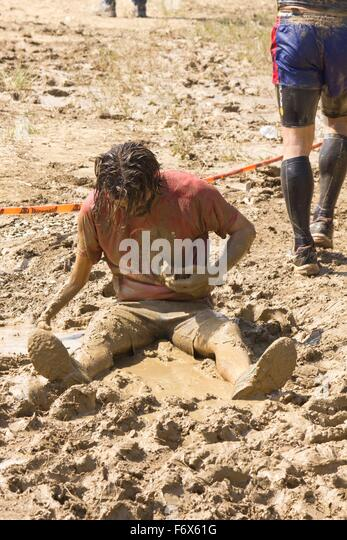 Signa Italy  city images : SIGNA, ITALY MAY 9 2015: Portrait of a man dirt sit in the mud ...