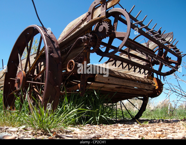 Farm Implement Pieces : Abandoned antique farm implement in stock photos