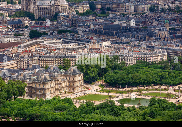 View from above on famous garden Jardin du Luxembourg and  Luxembourg Palace as typical parisian buildings on background - Stock Image