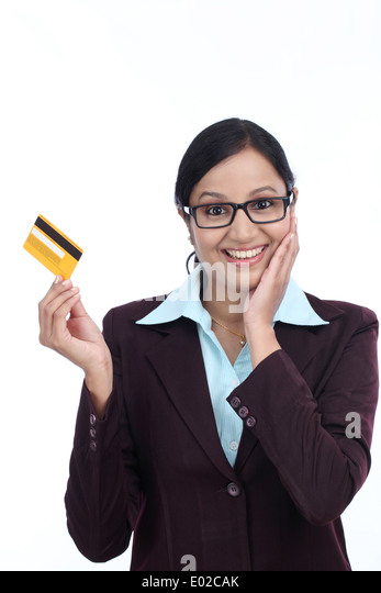 Indian lady showing credit card stock photos indian lady showing surprised young business woman with credit card against white background stock image reheart Choice Image